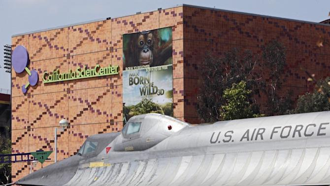 FILE - This file photo taken April 12, 2011, shows a Lockheed A-12 Blackbird displayed at the Roy A. Anderson Black Exhibit & Garden at the California Science Center Plaza in Los Angeles. A documentary on intelligent design, a theory of creation that has been dismissed by some in the scientific community as comparable to claiming the South won the Civil War, can be shown at the center under terms of a settlement announced Monday, August 29, 2011. (AP Photo/Damian Dovarganes, File)