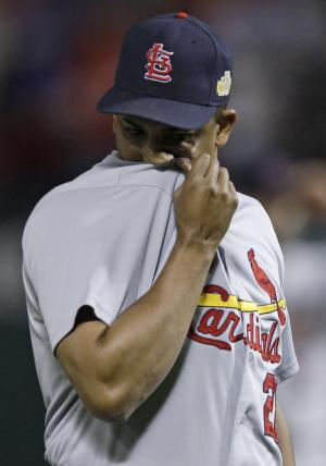 St. Louis Cardinals relief pitcher Octavio Dotel reacts during the eighth inning of Game 5 of baseball's World Series against the Texas Rangers Monday, Oct. 24, 2011, in Arlington, Texas. (AP Photo/Matt Slocum)