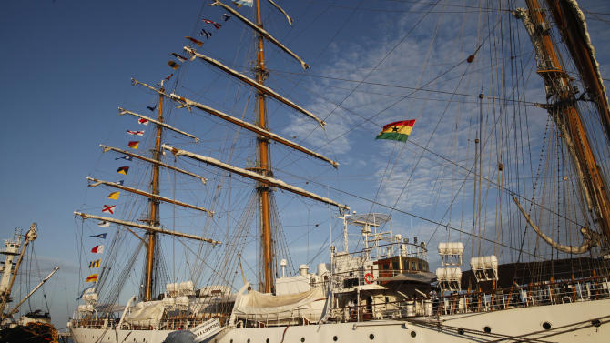 The three-masted ARA Libertad, a symbol of Argentina's navy, sits docked at the port in Tema, outside Accra, Ghana, Saturday, Oct. 20, 2012. Argentina announced the immediate evacuation Saturday of about 300 crew members from the Libertad, a navy training ship seized in Africa nearly three weeks ago as collateral for unpaid bonds dating from the South American nation's economic crisis a decade ago.(AP Photo/Gabriela Barnuevo)