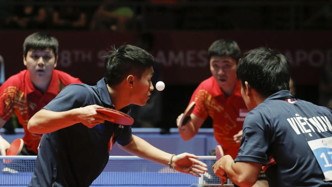 SPO TABLE TENNIS: Table Tennis - Singapore v Vietnam - Men's Doubles Semifinals - Singapore's Li Hu (L) and Gao Ning (2nd R), and Vietnam's Nguyen Anh Tu (2nd L) and Tran Tuan Quynh (R) in action