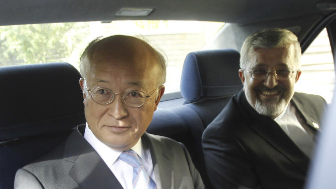International Atomic Energy Agency (IAEA) chief Yukiya Amano, left, sits in his car as he leaves at the conclusion of his meeting with Iran's top nuclear negotiator, Saeed Jalili, unseen, as Iran's chief delegate to the IAEA Ali Asghar Soltanieh looks on, in Tehran, Iran, Monday, 21, 2012. The head of the U.N. nuclear agency arrived Monday in Tehran on a key mission that could lead to the resumption of probes by the watchdog on whether Iran has secretly worked on an atomic weapon. It would also strength the Islamic Republic's negotiating hand in crucial nuclear talks with six world powers later this week in Baghdad. (AP Photo/IRNA,Adel Pazzyar)
