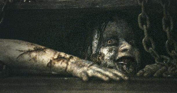 "This film image released by Sony-TriStar Pictures shows a scene from ""Evil Dead."" (AP Photo/Sony-TriStar Pictures)"