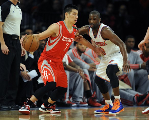 Houston Rockets' Jeremy Lin, left, drives on New York Knicks' Raymond Felton. (AP)