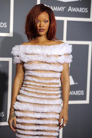 "FILE - This Feb. 13, 2011 file photo shows Rihanna at the 53rd annual Grammy Awards in Los Angeles. CBS has issued a memo to Grammy Awards attendees against baring too much skin at the ceremony Sunday. The network requests that ""buttocks and female breasts are adequately covered"" for the televised award show. The memo sent out Wednesday, Feb. 6, 2013, also warned against ""see-through clothing,"" exposure of ""the genital region"" and said that ""thong type costumes are problematic."" (AP Photo/Chris Pizzello, file)"