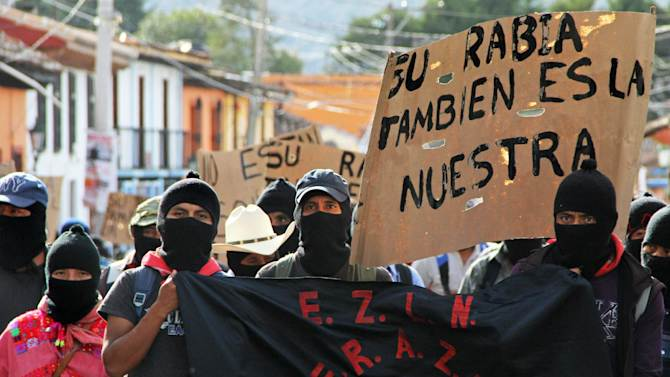 Hundreds of Zapatista militias march during a demostration in San Cristobal de las Casas, on October 8, 2014, to demand justice for 43 students that went missing in Iguala, Guerrero state