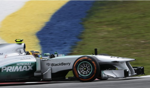Mercedes Formula One driver Lewis Hamilton of Britain drives during the third practice session of the Malaysian F1 Grand Prix at Sepang International Circuit outside Kuala Lumpur