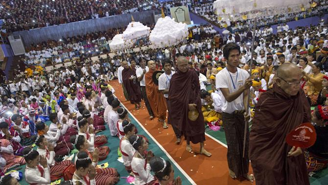 Leaders of radical Buddhist group Ma Ba Tha arrive during a celebration of the recent establishment of four controversial bills decried by rights groups as aimed at discriminating against the country's Muslim minority, at a rally in a stadium at Yangon