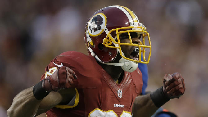 Washington Redskins wide receiver Pierre Garcon reacts to his reception during the first half of an NFL wild card playoff football game against the Seattle Seahawks in Landover, Md., Sunday, Jan. 6, 2013. (AP Photo/Matt Slocum)