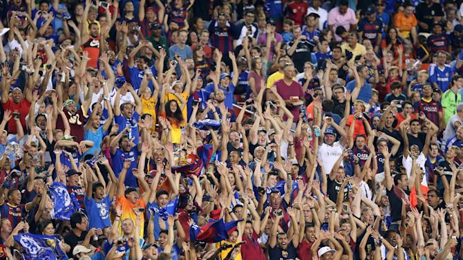 IMAGE DISTRIBUTED FOR INTERNATIONAL CHAMPIONS CUP - Fans in action on Tuesday, July 28,2015, in Landover, Maryland. Chelsea and FC Barcelona face off at the 2015 International Champions Cup. (Damian Strohmeyer/AP Images for International Champions Cup)