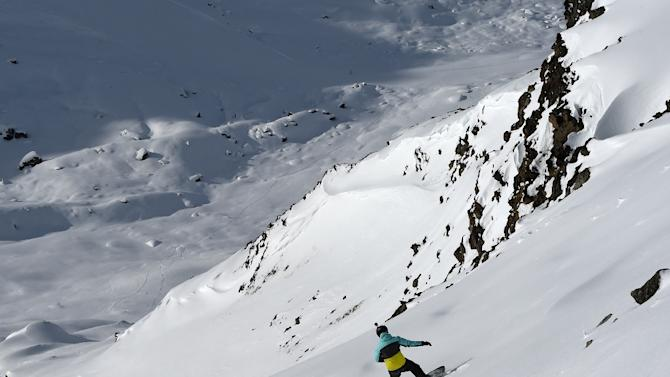 A man surfs off of marked ski slopes despite of an avalanch risk, on February 2, 2016 in the French ski resort of Meribel in the 3 Valleys ski area, the world's largest ski area, in central French Alps