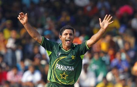 Pakistan's Razzaq celebrates taking the wicket of Australia's Clarke during their ICC Cricket World Cup group A match in Colombo