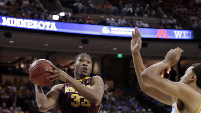 Minnesota's Rodney Williams (33) goes up for a shot as UCLA's Kyle Anderson, right, during the first half of a second-round game of the NCAA men's college basketball tournament Friday, March 22, 2013, in Austin, Texas. (AP Photo/David J. Phillip)