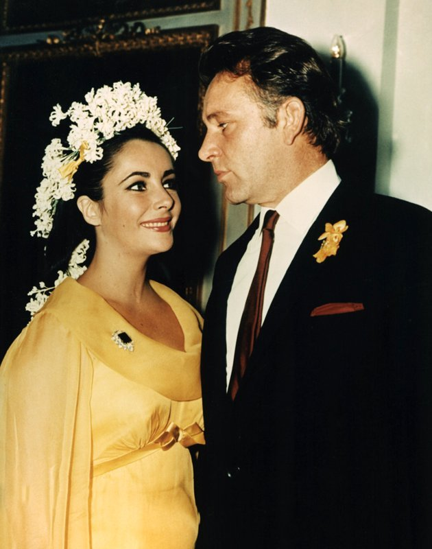 When you get married as many times as Elizabeth Taylor did (eight times to seven different guys!) it's easy to get sick of white. The iconic actress chose this yellow, long-sleeve dress created by