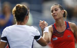 Pennetta of Italy is congratulated by Halep of Romania after her victory at the U.S. Open tennis championships in New York