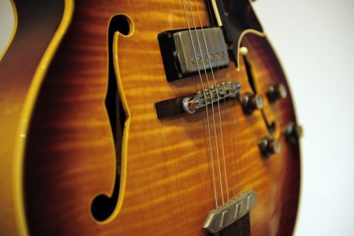 This file photo shows a vintage Gibson electric guitar, pictured in 2011. Gibson has agreed to pay $350,000 to avoid US prosecution over allegations it illegally imported endangered wood from India and Madagascar, according to officials.