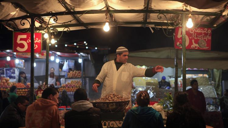 A Moroccan man serves traditional soup at a market in Djemaa el-Fna square, a popular tourist area in the center of Marrakech