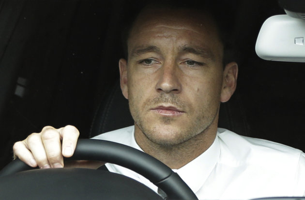 ALTERNATE CROP OF LLP101 Former England soccer captain John Terry drives out of Wembley Stadium in London, Tuesday, Sept. 25, 2012, where the Football Association hearing on a racism charge against him was held. Terry&#39;s racism hearing started Monday, a day after the 31-year-old Chelsea defender quit England duty in protest at the case being pursued by the Football Association. Terry was charged by the FA despite being cleared in court of racially abusing Queens Park Rangers defender Anton Ferdinand during a Premier League match in October. (AP Photo/Lefteris Pitarakis)