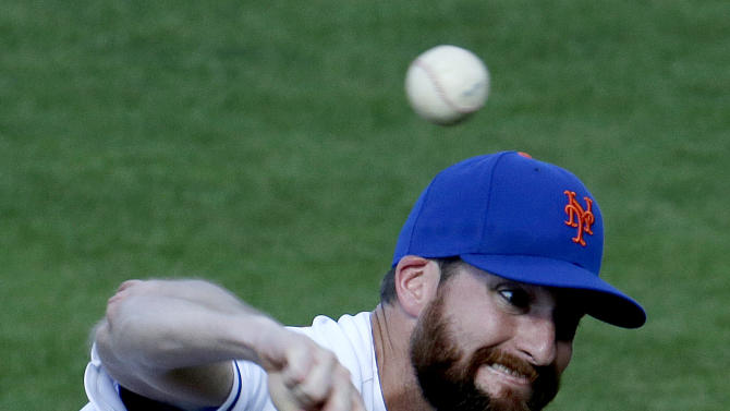 New York Mets relief pitcher Bobby Parnell throws a pitch during the ninth inning of an exhibition spring training baseball game against the Washington Nationals in Port St. Lucie, Fla., Saturday, Feb. 23, 2013. The Mets won 5-3. (AP Photo/Julio Cortez)