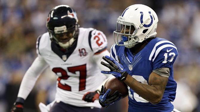Indianapolis Colts' T.Y. Hilton (13) makes a 70-yard touchdown reception against Houston Texans' Quintin Demps (27) during the second half of an NFL football game, Sunday, Dec. 30, 2012, in Indianapolis. (AP Photo/Michael Conroy)
