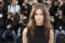 "File - In this May 16, 2013 file photo, actress Marine Vacth poses for photographers during a photo call for the film Young & Beautiful at the 66th international film festival, in Cannes, southern France. Cannes has been the birthplace of many a star, and the latest candidate to shine is Marine Vacth, who plays in Francois Ozon's ""Young and Beautiful"" (AP Photo/Francois Mori)"
