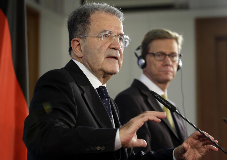 German Foreign Minister Guido Westerwelle, right, and the President of the African Union-UN peacekeeping panel, Romano Prodi, left, address the media during a press conference after a meeting on the situation in Mali at the Foreign Office in Berlin, Germany, Tuesday, Oct. 23, 2012. (AP Photo/Michael Sohn)