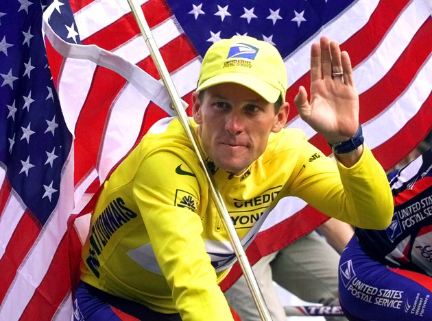 FILE - In this July 23, 2000, file photo, winner Lance Armstrong rides down the Champs Elysees after the final stage of the Tour de France cycling race in Paris. Armstrong also won the Prince of Asturias Award in Sports in 2000. Armstrong was stripped of his seven Tour de France titles and banned for life by cycling&#39;s governing body following a report from the U.S. Anti-Doping Agency that accused him of leading a massive doping program on his teams. (AP Photo/Laurent Rebours, File)