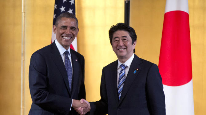 FILE - In this April 24, 2014 file photo, President Barack Obama shakes hands with Japanese Prime Minister Shinzo Abe as they arrive to participate in a bilateral meeting at the Akasaka State Guest House in Tokyo. Seventy years after the end of World War II, Japan wants to look to the future but can't shake off its past. When Prime Minister Shinzo Abe visits the U.S. next week, he will be promoting a regional free trade pact and stronger defense ties with America as his government loosens the shackles of Japan's pacifist constitution. (AP Photo/Carolyn Kaster, File)