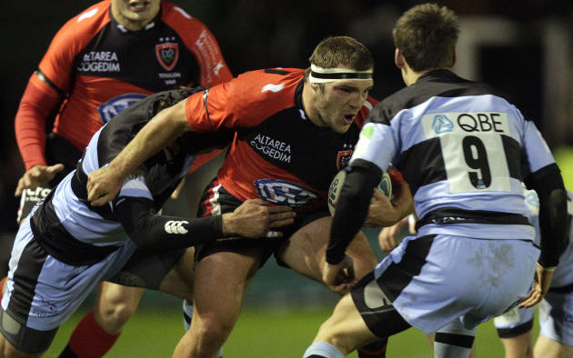 Newcastle Falcons' Ryan Shortland (L) and Jordi Pasqualin (R) tackles Toulon's Jean-Charles Orioli (2R) during a pool 2, European Challenge Cup rugby union match at Kingston Park, Newcastle upon Tyne