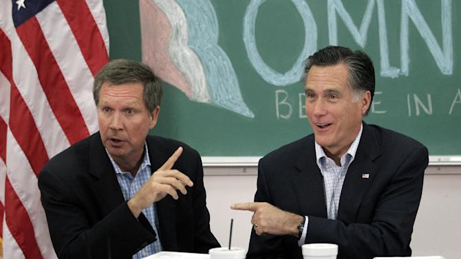 FILE - In this April 27, 2012 file photo, former Massachusetts Gov. Mitt Romney, right, and Ohio Gov. John Kasich participate in a roundtable discussion in Westerville, Ohio. No matter how long the nation's unemployment rate hovered around 8 percent, the Northeast and the West Coast were never in doubt for President Barack Obama. No matter how far it might have fallen before Election Day, Mitt Romney was always sure to win the South and rural Great Plains. Nothing was so certain in the Midwest. Tuesday's results reaffirmed the future of the Midwest as a political battleground where voters willing to look past party will decide the outcome of elections. (AP Photo/Jae C. Hong, File)