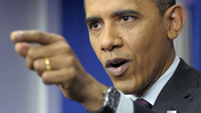 President Barack Obama points toward a reporter during a news conference in the James Brady Press Briefing Room of the White House in Washington, Tuesday, March 6, 2012.  (AP Photo/Susan Walsh)