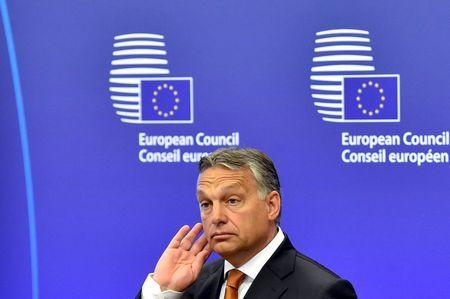Hungary's Prime Minister Orban gives a news conference with European Council President Tusk at the European Council headquarters ahead of their meeting in Brussels
