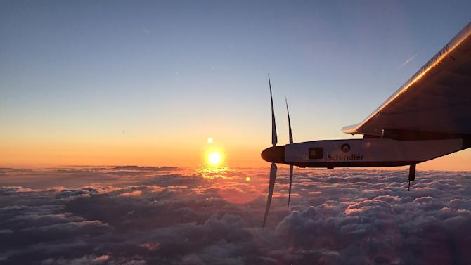 This handout photo taken early on June 29, 2015 and provided by the Solar Impulse project shows sunrise a little while after the Swiss-made solar-powered plane Solar Impulse 2 took off from the international airport in Nagoya, Japan
