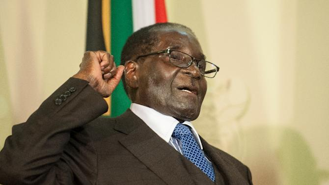 "Robert Mugabe walked away from a group of journalists in South Africa commenting ""I don't want to see a white man"", television footage shows"