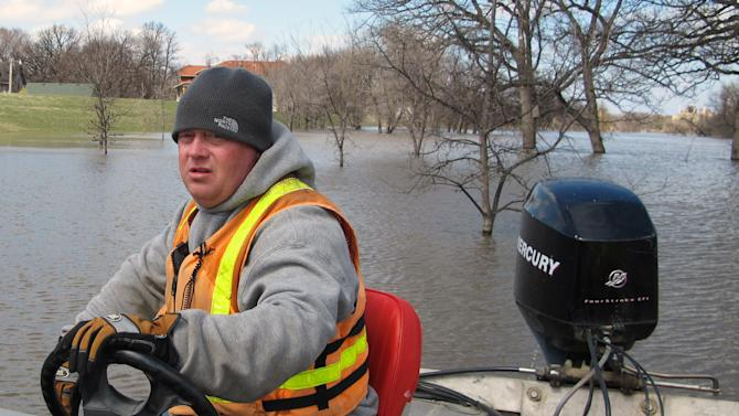 FILE - In this April 30, 2013 file photo, Mike Andersen of the US Geological Survey maneuvers a boat on the Red River in Fargo, N.D., so a USGA hydrologist can take stream flow measurements. Big money water projects used to be a favorite target of good-government types who railed against political pork. Now the same projects are a rare unifying factor in a dysfunctional Congress. (AP Photo/Dave Kolpack, File)