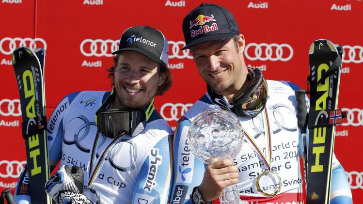 Overall winner Svindal of Norway and second placed compatriot Jansrud celebrate after men's Super G competition during the FIS Alpine Skiing World Cup finals in the Swiss ski resort of Lenzerheide