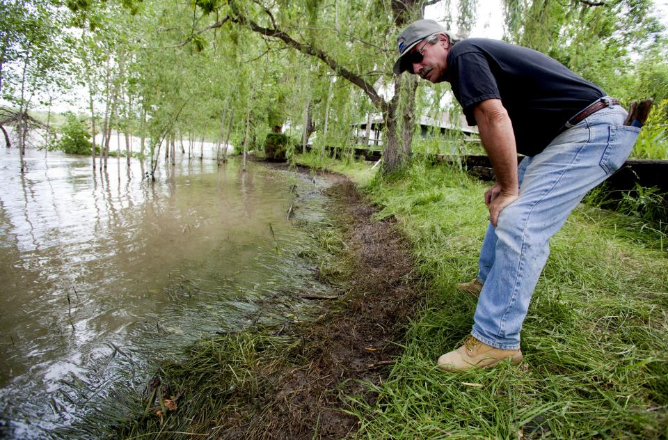 Jim Swanson surveys the oil impact on his property in Laurel, Mont., Tuesday July 4, 2011.  An ExxonMobil pipeline near Laurel, Mont., ruptured and spilled an estimated 1,000 barrels of crude oil into the Yellowstone. last weekend. (AP Photo/Jim Urquhart)