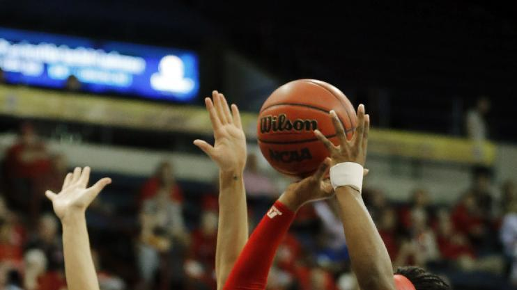 Western Kentucky Lady Toppers guard Chanell Lockhart (4) shoots around Arkansas State Red Wolves guard Hanna Qedan (2) in the first half of the Sun Belt Women's Conference Championship NCAA basketball game in New Orleans, Saturday, March 15, 2014. (AP Photo/Bill Haber)