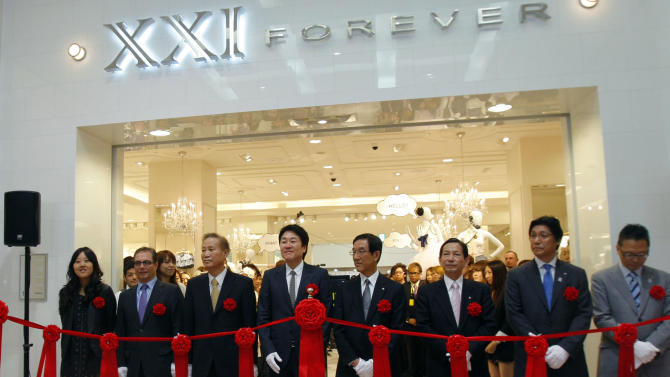 FILE-In this Thursday, April 29, 2010, file photo, Jin Sook Chang,  left, attends the opening of a Forever 21 store in Tokyo. Sook and husband Do Won created the Forever 21 clothing chain, which now spans nearly 500 stores. The couple is No. 79 on this year's Forbes 400 list of richest Americans. Women have helped build some of the biggest companies in America, and they have the bank accounts to show for it. (AP Photo/Shuji Kajiyama, File)