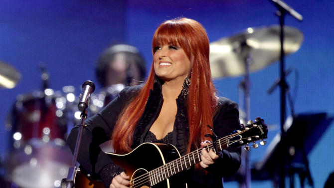 FILE - This April 4, 2011 file photo shows country winger Wynonna Judd from The Judds, performing at the Girls' Night Out: Superstar Women of Country in Las Vegas.  Judd says she is postponing scheduled concerts in Canada next week after her husband was hurt in a motorcycling accident in South Dakota, Saturday, Aug. 19, 2012. (AP Photo/Julie Jacobson, file)