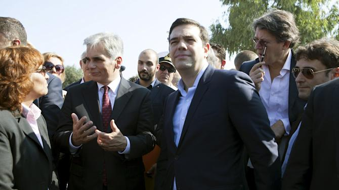 Greek PM Tsipras and Austrian Chancellor Faymann visit a refugee camp for Syrians at the city of Mytilene on the island of Lesbos