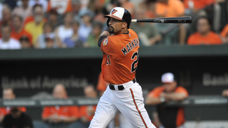 Baltimore Orioles' Nick Markakis follows through on a single against the New York Yankees in the first inning of a baseball game, Saturday, June 29, 2013, in Baltimore. AP Photo/Gail Burton)