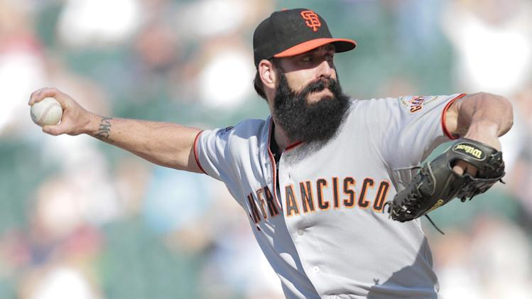 San Francisco Giants relief pitcher Brian Wilson (38) pitches against Colorado Rockies' Eric Young Jr. during the eighth inning of a baseball game Sunday, Sept. 18, 2011 in Denver. The Giants won 12-5.  (AP Photo/Barry Gutierrez)