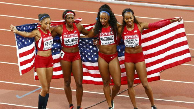 The U.S. team celebrate after the women's 4 x 400 metres relay final  during the 15th IAAF World Championships at the National Stadium in Beijing