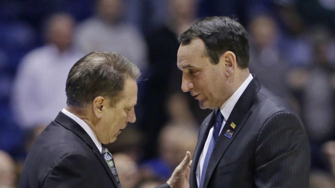 Duke head coach Mike Krzyzewski, right, talks to Michigan State head coach Tom Izzo after their regional semifinal in the NCAA college basketball tournament, Saturday, March 30, 2013, in Indianapolis. Duke won 71-61. (AP Photo/Darron Cummings)
