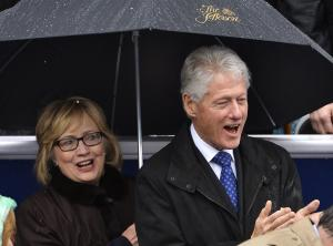 Former U.S. President Clinton and his wife Hillary…