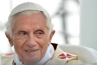 Pope Benedict XVI has made an attempt to appease remarried Catholic divorcees by calling on parishes to integrate them, but he is a long way from changing the rules, Vatican watchers said Monday
