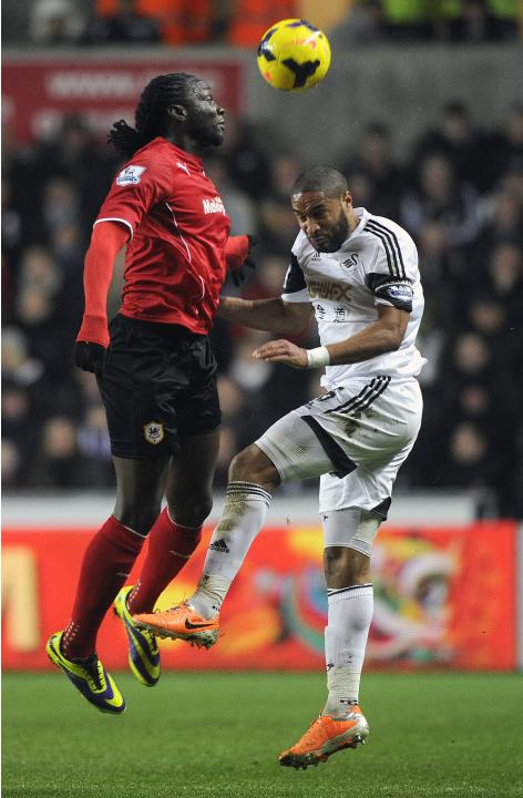 Swansea City's Williams challenges Cardiff City's Jones during their English Premier League match in Swansea