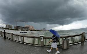 A beach goer leaves the pier on Clearwater beach as…