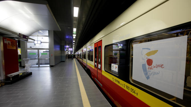 A new local train that will carry Euro 2012 football fans between Warsaw's Frederic Chopin airport, the city center and the National Stadium, where the tournament will kick off June 8, was inaugurated in Warsaw, Poland on Thursday, May 31, 2012, and is seen here in the Central station. Poland has taken huge strides to upgrade its travel infrastructure and facilities for the hundreds of thousands of foreign and Polish fans expected for the  tournament, co-hosted with neighboring Ukraine, and held in the cities of Warsaw, Wroclaw, Poznan and Gdansk, and will run through July 1. (AP Photo/Czarek Sokolowski)