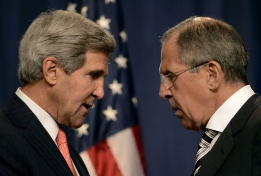 US Secretary of State John Kerry (L) speaks with Russian Foreign Minister Sergey Lavrov (R) before a press conference in Geneva on September 14, 2013